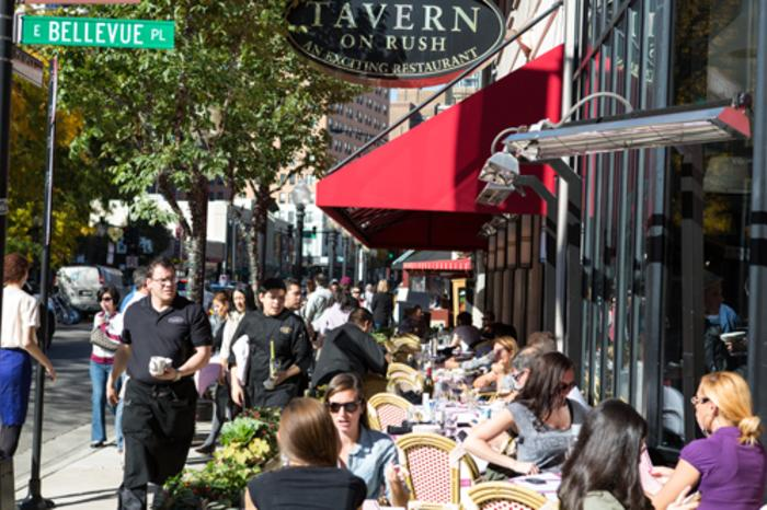 People dining on the side walk cafe at Tavern on Rush in Chicago