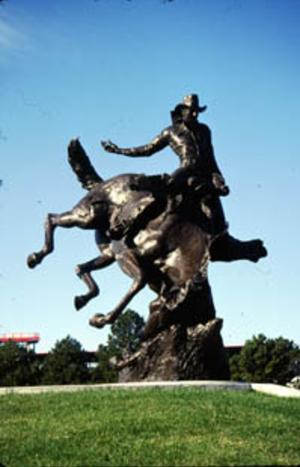 Bronze statue of a cowboy being bucked off by a bronco