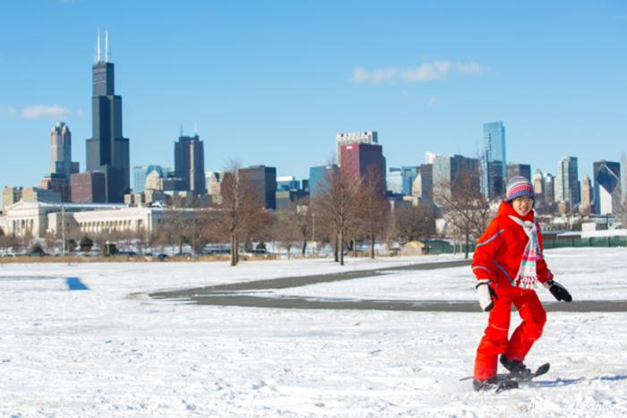 Kid snowshoeing through Northerly Island in Chicago
