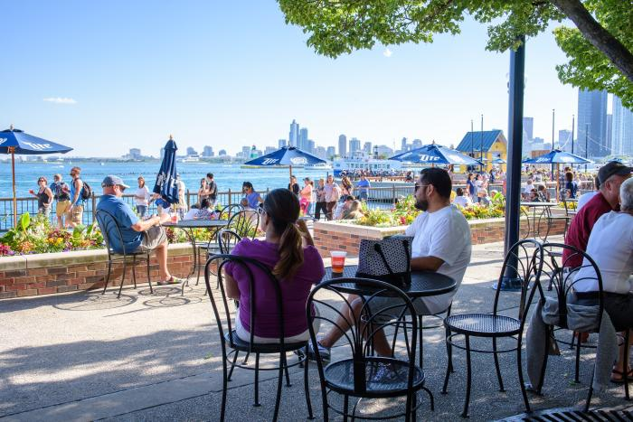 People dining on the patio of the Navy Pier Beer Garden in Chicago