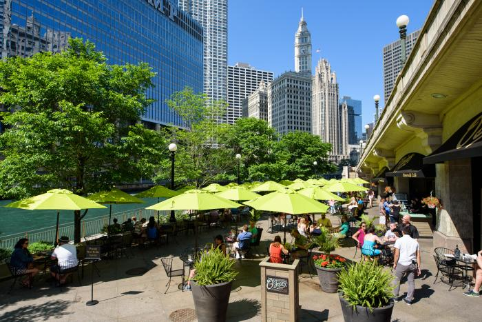 People dining at O'Briens patio on the Chicago Riverwalk