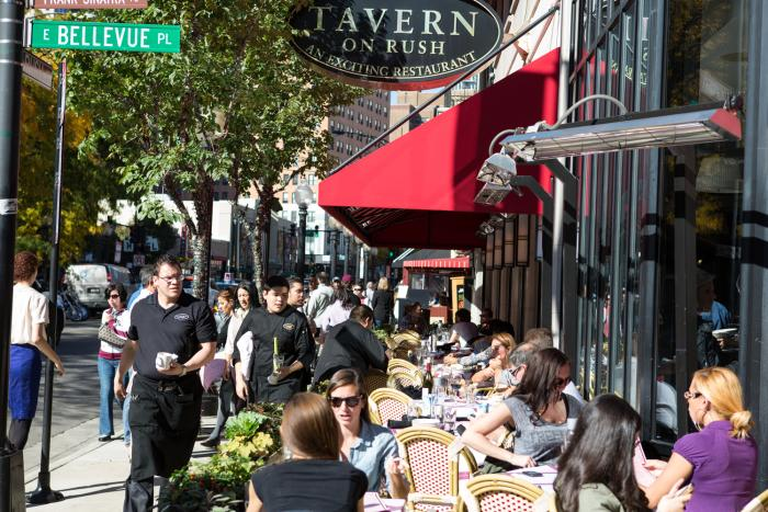 People dining on sidewalk patio at Tavern on Rush in Chicago
