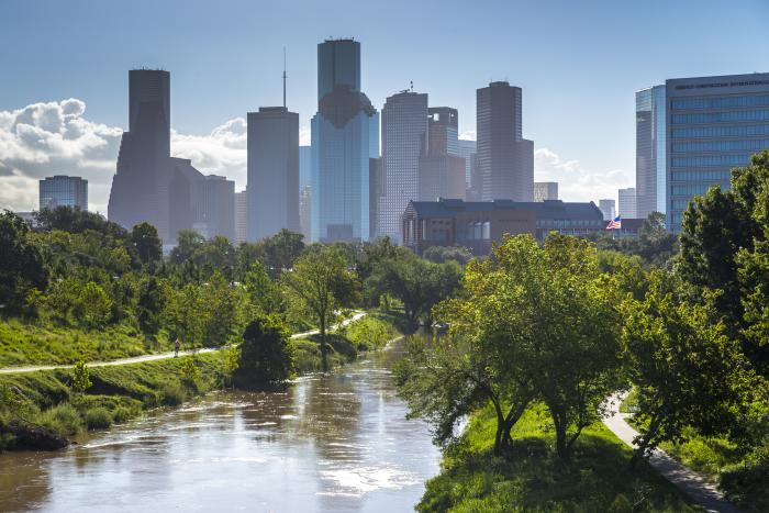 River in Buffalo Bayou Park with Houston skyline