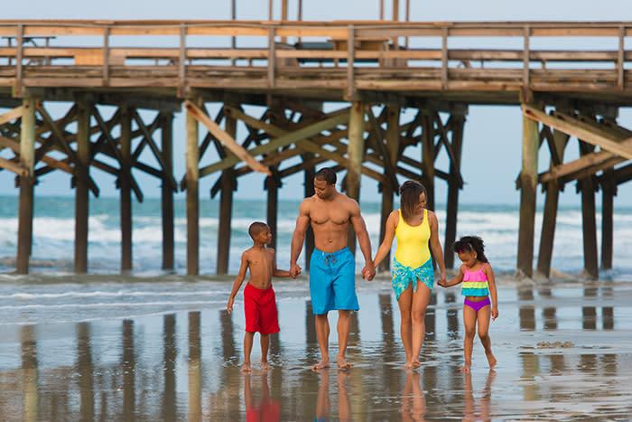 Family Walking by Pier