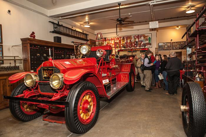 A group tour explores the exhibits at the Fire Museum in Beaumont.