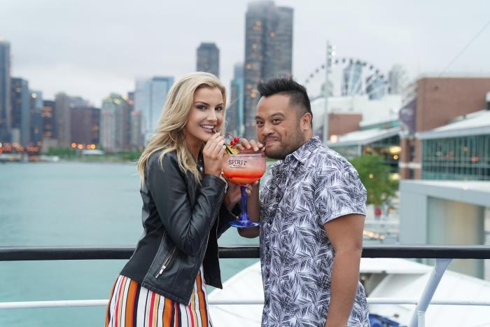 Couple sharing a drink on A Spirit of Chicago dinner cruise on Lake Michigan