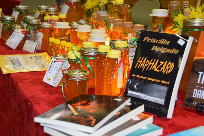 a table full of golden honey jars