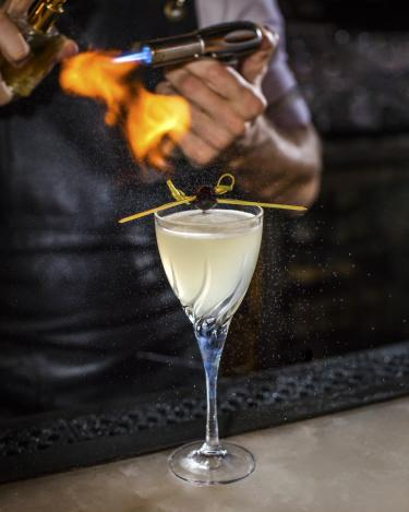 Corpse Reviver number 2 cocktail with gin triple sec cocchi americano lemon and flamed absinthe from the Roosevelt Room in Austin Texas