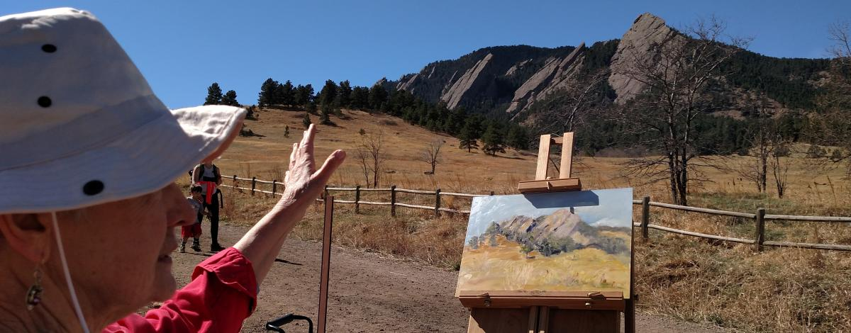 Painter in Front of Flatirons Boulder