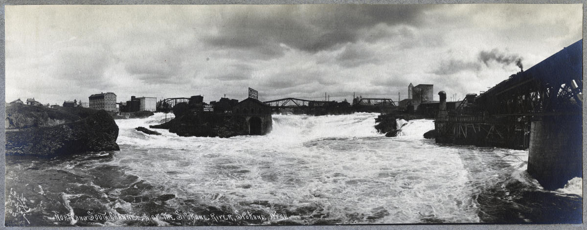 Black and white photo of the upper Spokane Falls taken in the early 1900s.