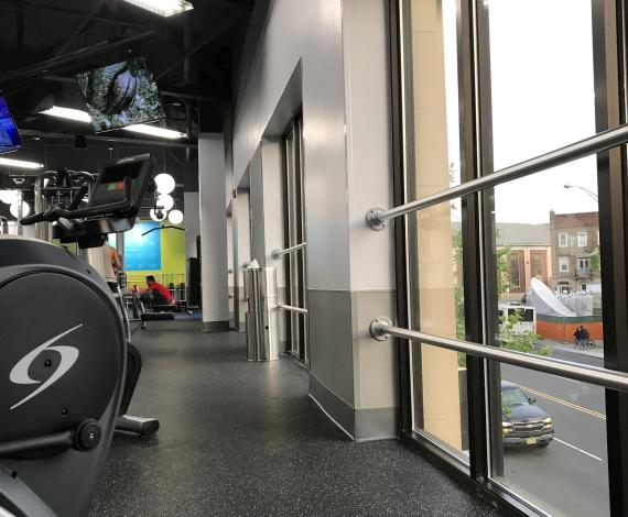 Inside of Blink Fitness Machines Overlooking Street