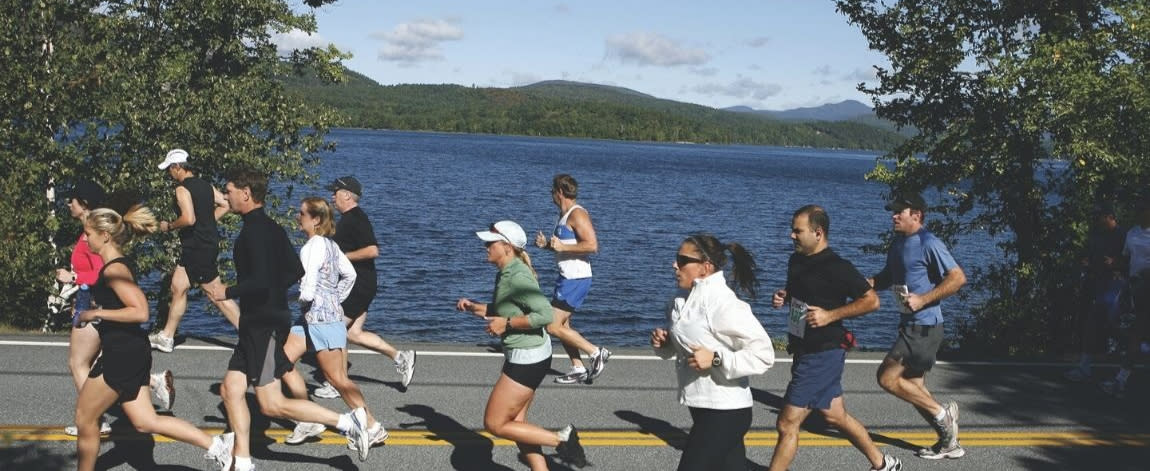 Runners run along the lake during the Adirondack Distance Festival