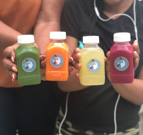 People hold up a selection of tiny but powerful flavors from Juicing Jammer in Dayton.