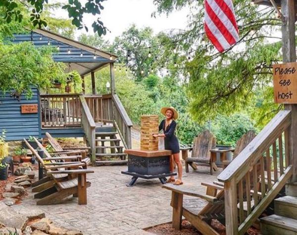 Rachel Holtin on wooded patio