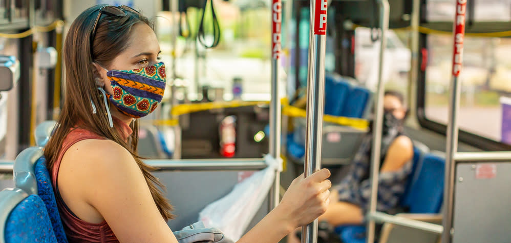 Woman wearing a face mask riding the Park to Park shuttle in Boulder