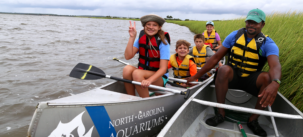 NC Aquarium Summer Camp kids Canoeing with volunteer