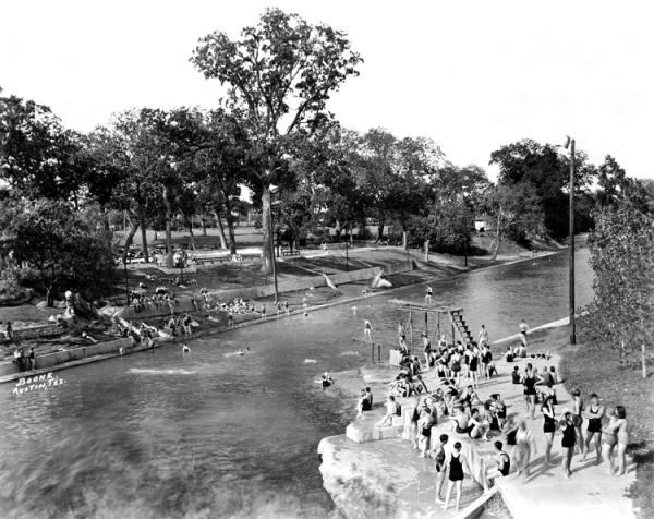 black and white historic photograph of Barton Springs Pool