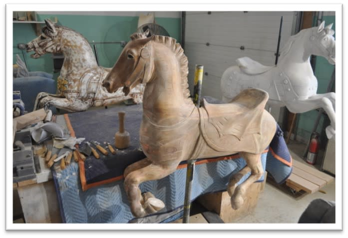 Carousel horse completely stripped of old paint standing upright