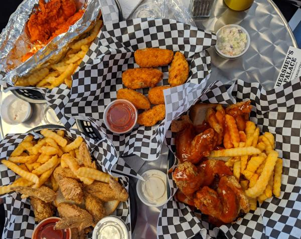 Photo of baskets of food with chicken wings and french fries