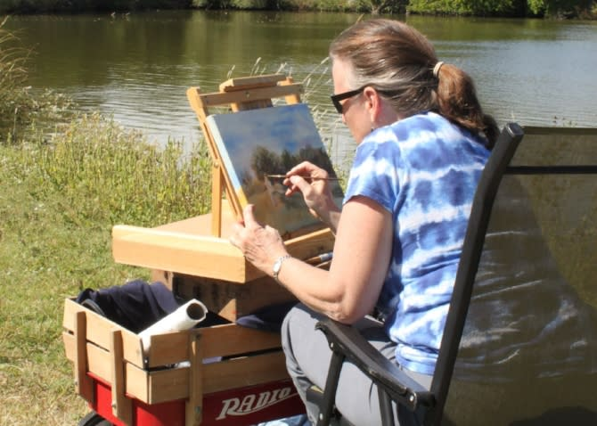 artists paints during art on the trail at great plains nature center in wichita ks