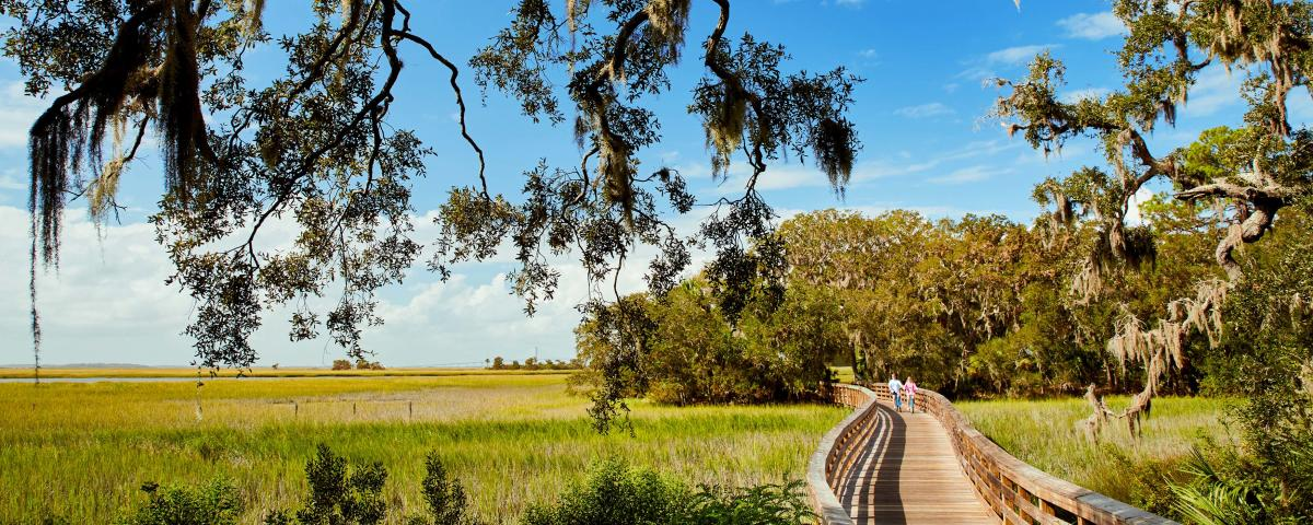 A couple enjoys a bike ride along the Jekyll Island Trail System