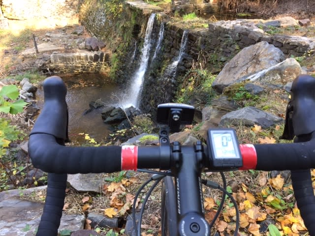 Biking in the fall by a waterfall