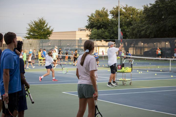 Players and spectators alike enjoy the energy in the air at the Grapefest Tennis Classic.