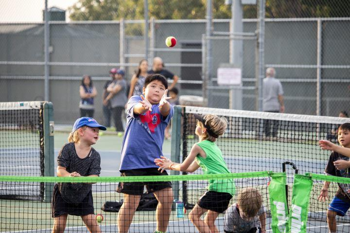 You don't always need a tennis racquet to have fun at the Grapefest Tennis Classic.
