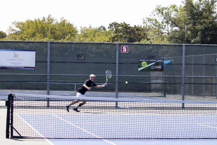 A player dances on the court during a singles match at the annual Grapefest Tennis Classic.