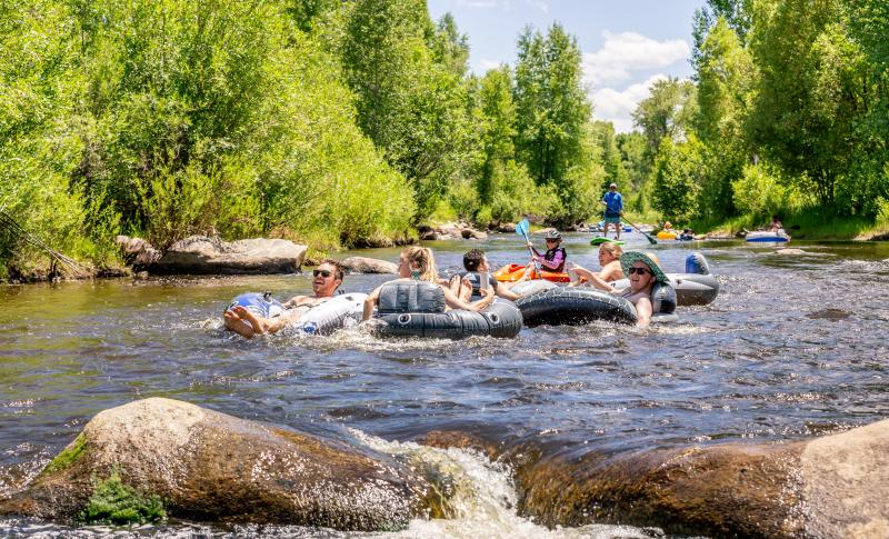 Families enjoy tubing the yampa river through downtown Steamboat Springs