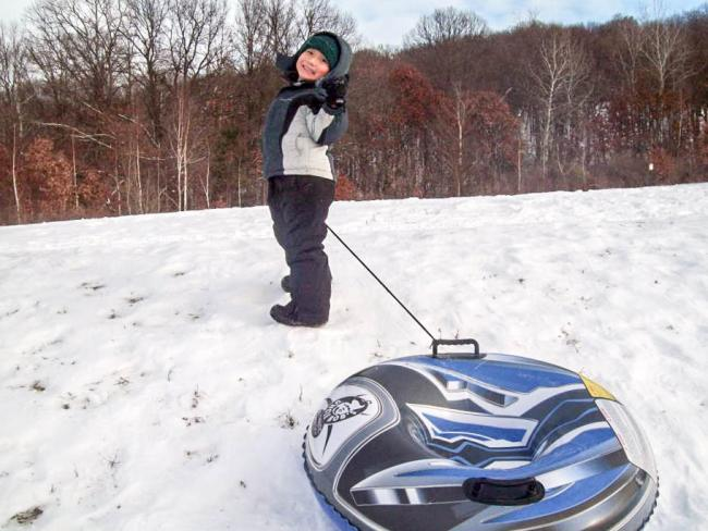 Child In Snow With Sled