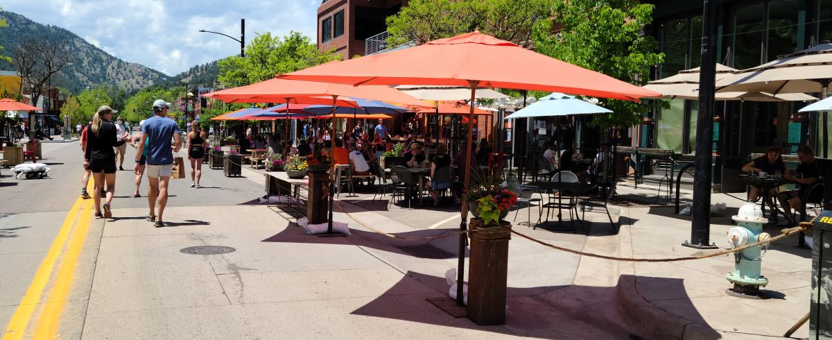 People walking and dining outdoors in Downtown Boulder Streets