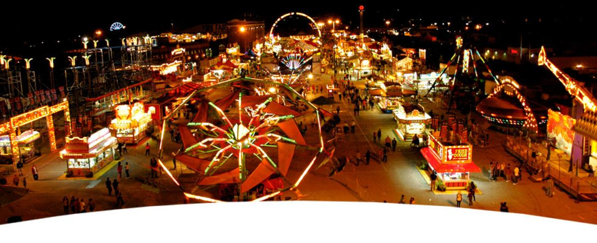 aerial view of a carnival lit up at night