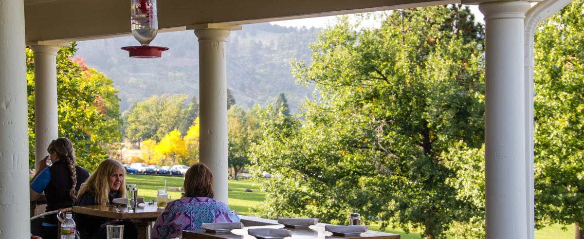People dining on the patio at Chautauqua Dining Hall in Boulder