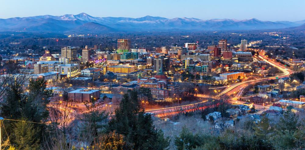 Asheville, NC winter skyline with snow-capped mountains