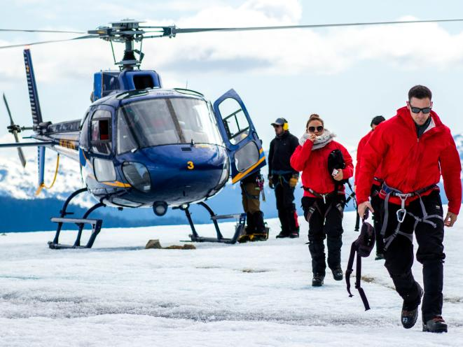 Guests walking from heli