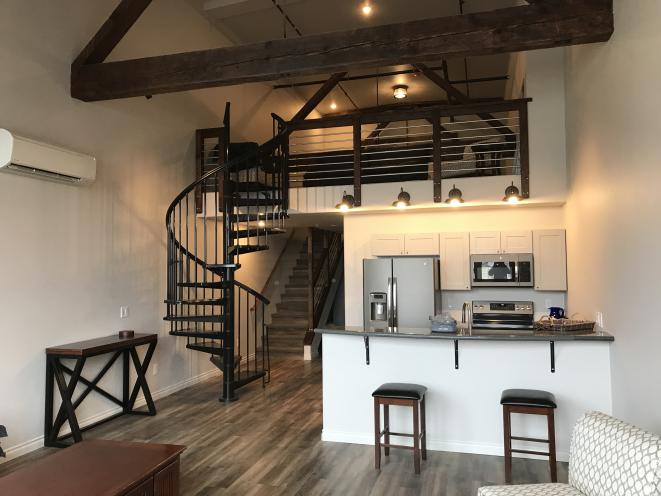 Kitchen and upstairs in loft apartment 302