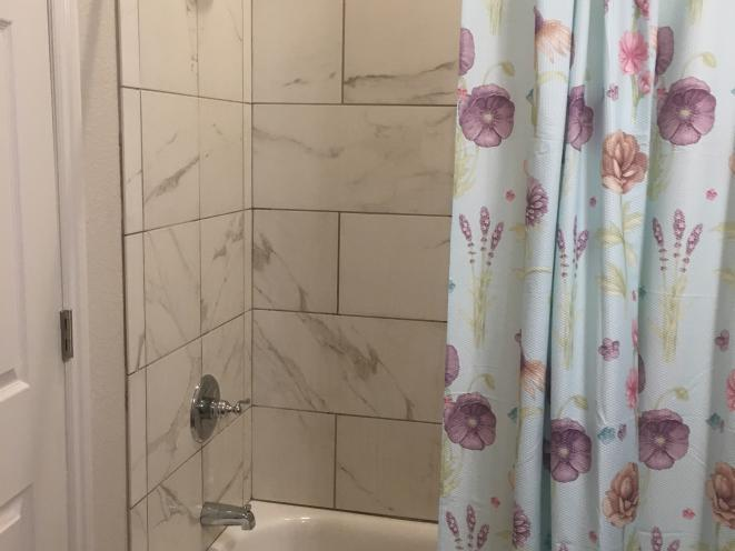 Porcelain tile bathroom in every apartment