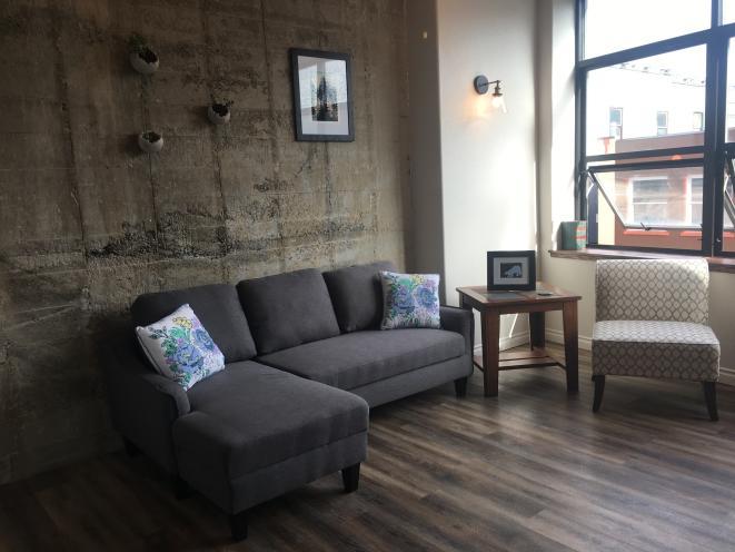 Living area in studio apartment 201