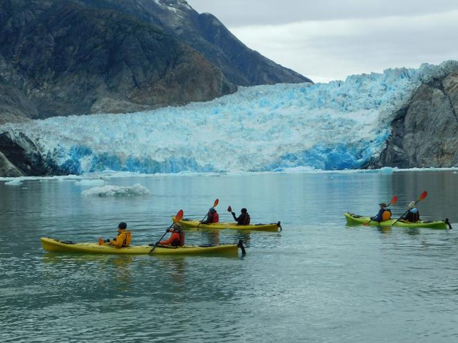Kayaking in front of a glacier - UnCruise Adventures