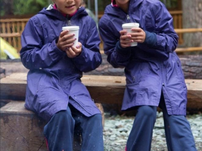 Enjoy hot chocolate by the fire.