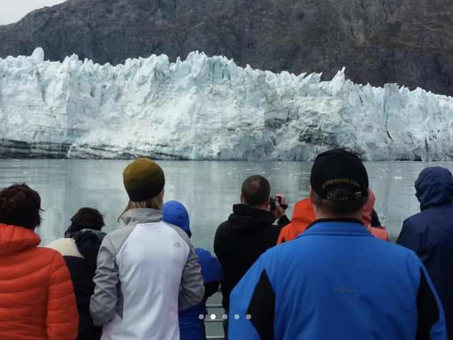 Visitors in awe at Margerie Glacier in Glacier Bay National Park.