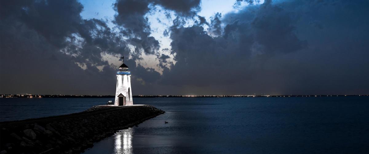 Lake Hefner Lighthouse lit up at night