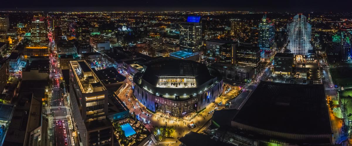 Aerial view at night of Golden1 Center, the Kimpton, and the downtown skyline.