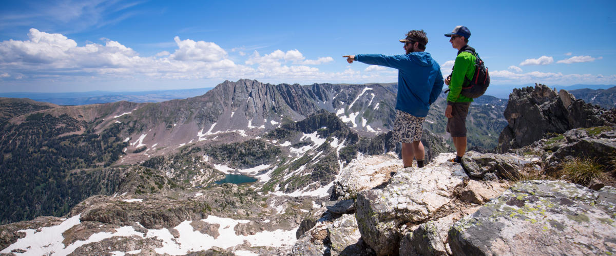 Hikers take in the view in the Zirkel Wilderness Area outside of Steamboat Springs, CO