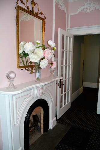 Saratoga Arms pink and white dining room fireplace