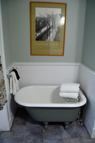 Tiny bathtub in alcove of gray bathroom