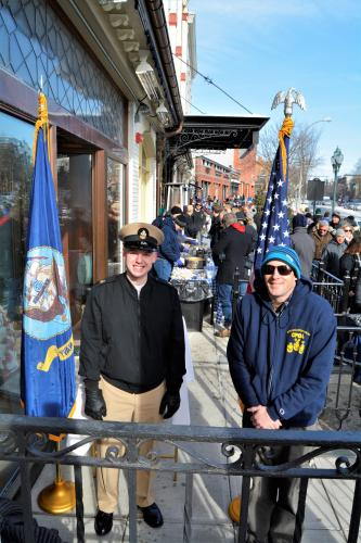 Navy officers posing with flag
