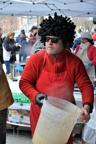 Guy serving with Fro wig
