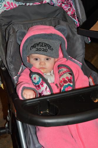 Baby wearing CF hat in stroller